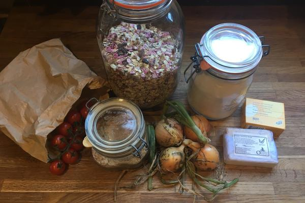 Photo of an assortment of foods and toiletries in paper packaging and glass jars