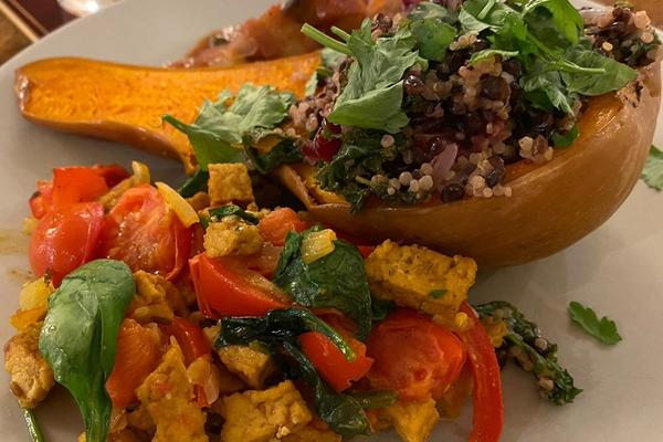 Photo of a roasted butternut squash stuffed with grains