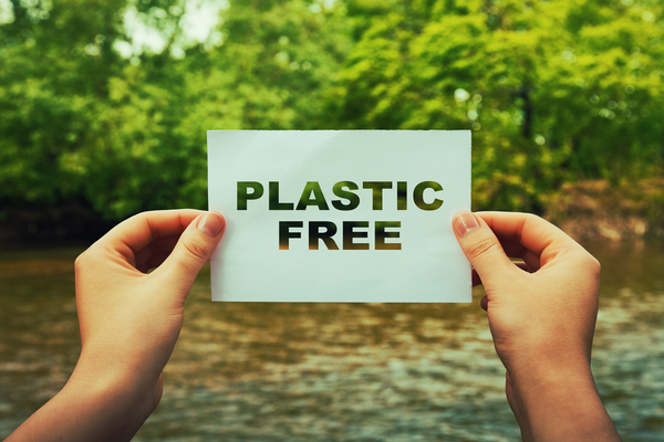 Image of a plastic free sign being held up