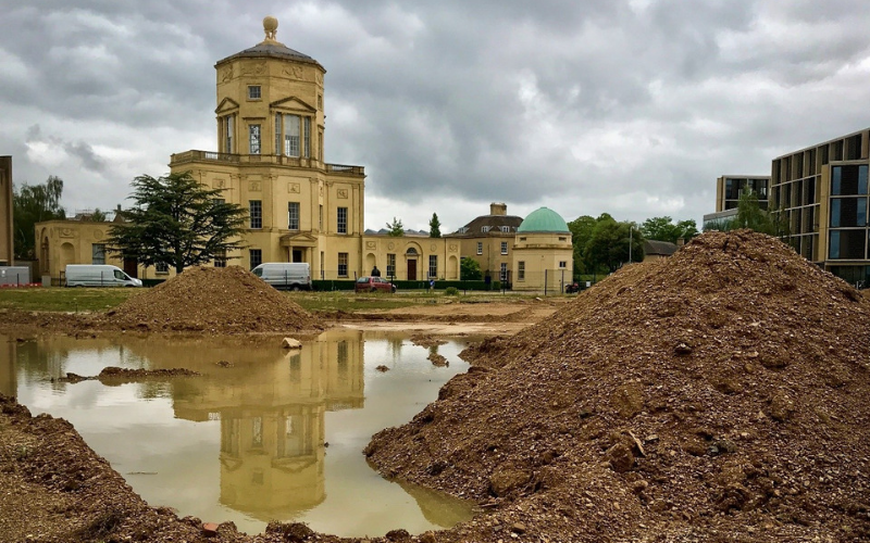 Radcliffe Observatory with reflection in large puddle