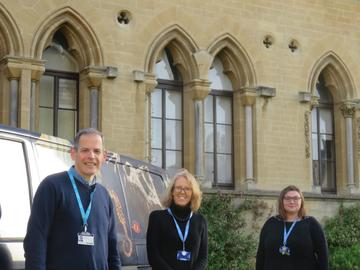 Photo of Rodger Caseby, Kate Jaeger, and Susie Glover standing outside the Oxford University Museum of Natural History