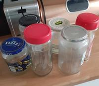 Photo of six assorted glass jars on a kitchen counter